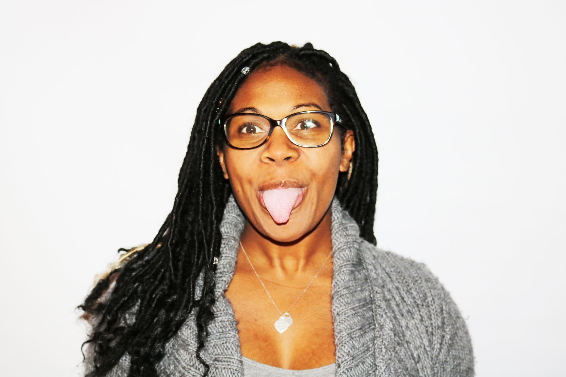 photography of woman showing her tongue